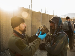 A contractor captures biological data of a local man in the Laghman province of Afghanistan, December 14, 2014