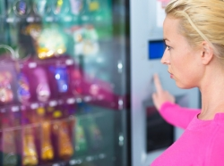 Lady using a modern vending machine
