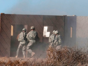 U.S. soldiers rush a building during a platoon live-fire demonstration for Iraqi army trainees and officers on Camp Taji, Iraq, Feb. 5, 2015, photo by Staff Sgt. Daniel Stoutamire/U.S. Army
