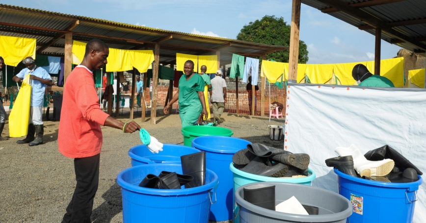 Medicins Sans Frontieres health workers disinfect protection clothes and boots outside the isolation unit at ELWA hospital in Monrovia August 23, 2014