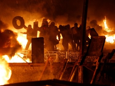 Anti-government protesters at the site of clashes with riot police in Kiev on January 25, 2014