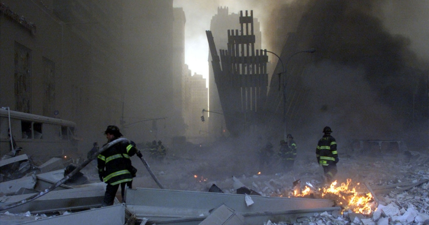Firemen work around the World Trade Center after both towers were attacked by terrorists on September 11, 2001