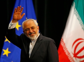 Iranian Foreign Minister Mohammad Javad Zarif waves after a plenary session at the UN building, Vienna, July 14, 2015, photo by Leonhard Foeger/Reuters