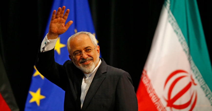 Iranian Foreign Minister Mohammad Javad Zarif waves after a plenary session at the UN building, Vienna, July 14, 2015