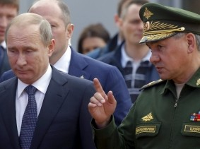 Russian President Vladimir Putin and Defence Minister Sergei Shoigu arriving for the opening of the Army-2015 international military forum in Kubinka, Russia, June 16, 2015