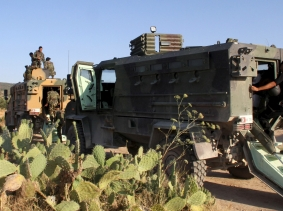 Tunisian soldiers and police patrol near Algeria's border in Kasserine, Tunisia July 4, 2015 after an Islamist militant attack on a beach hotel that killed 38 foreigners