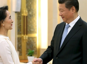 Myanmar pro-democracy leader Aung San Suu Kyi and China's President Xi Jinping meet at the Great Hall of the People in Beijing, China, June 11, 2015
