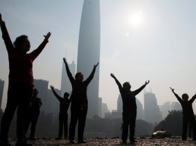 Residents do morning exercises at a park on a hazy day in Shenzhen, Guangdong province February 12, 2015