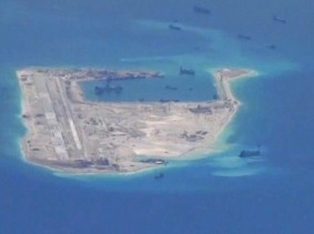 Chinese dredging vessels are purportedly seen around Fiery Cross Reef in the disputed Spratly Islands in the South China Sea May 21, 2015