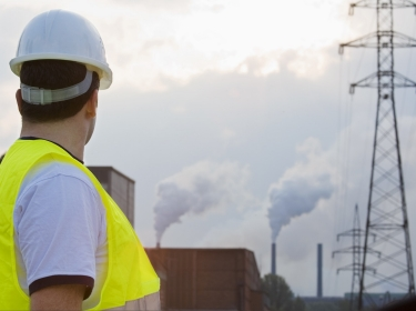 Engineer looking at factory emissions