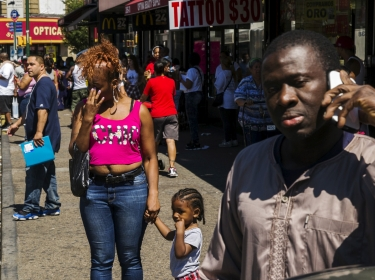 Pedestrians in a region of the South Bronx that has seen a deadly outbreak of Legionnaires' disease in New York August 7, 2015