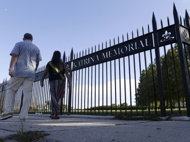 Tourists walk past the entrance to the Hurricane Katrina Memorial, New Orleans, Louisiana, August 23, 2015