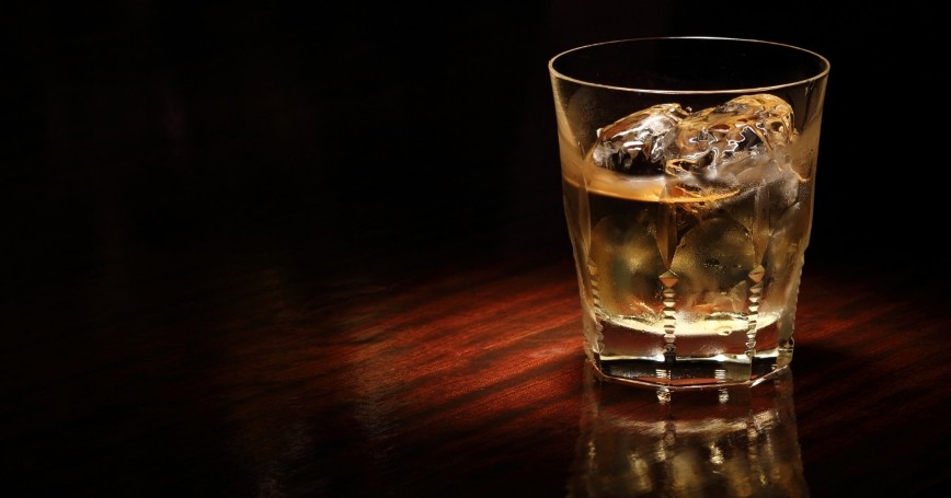 A glass of whiskey on ice
