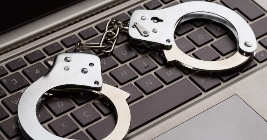 Handcuffs on a computer keyboard