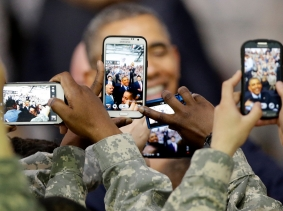 U.S. soldiers take pictures of President Barack Obama at U.S. military base Yongsan Garrison in Seoul, South Korea, April 26, 2014