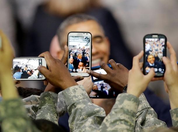 U.S. soldiers take pictures of President Barack Obama at U.S. military base Yongsan Garrison in Seoul, South Korea, April 26, 2014