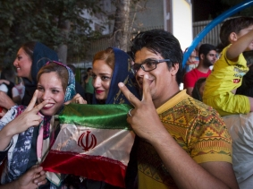 Iranians celebrate after the announcement of a nuclear deal between Iran and the P5+1 countries, Tehran, July 14, 2015, photo by TIMA/Reuters