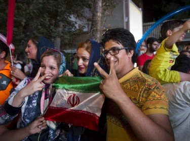 Iranians celebrate after the announcement of a nuclear deal between Iran and the P5+1 countries, Tehran, July 14, 2015