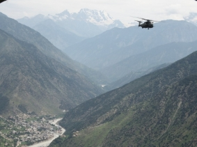 A U.S. Navy MH-53E Sea Dragon helicopter flies over Kalam Valley during humanitarian relief efforts in Pakistan, August 2010, photo by Capt. Paul Duncan/U.S. Marine Corps