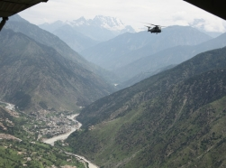 A U.S. Navy MH-53E Sea Dragon helicopter flies over Kalam Valley during humanitarian relief efforts in Pakistan, August 2010