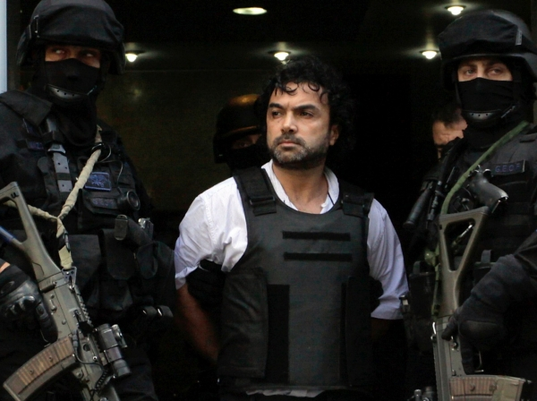 Argentine policemen escort Henry de Jesus Lopez Londono, alleged leader of a Colombian drug trafficking group, outside a courthouse in Buenos Aires October 31, 2012