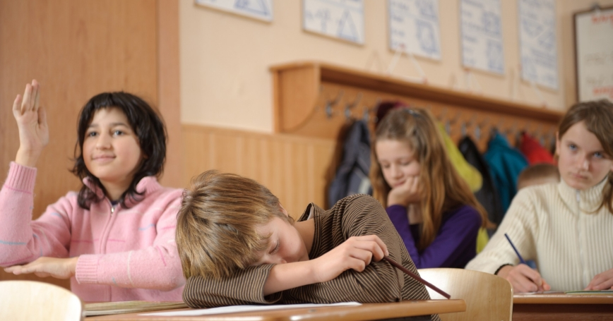 Adolescent boy asleep in a classroom