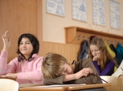 Adolescent boy asleep in a classroom