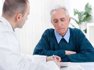 A senior man receives a consultation from his doctor
