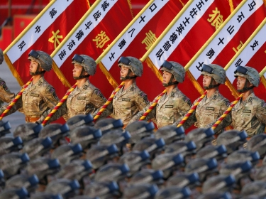 Soldiers of the China's People's Liberation Army stand in formation ahead of a military parade marking the 70th anniversary of the end of World War II, Beijing, September 3, 2015