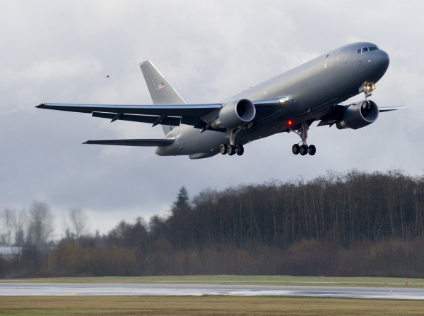 The KC-46A Pegasus aerial refueling aircraft takes off on its maiden flight from Paine Field in Everett, Washington, December 28, 2014