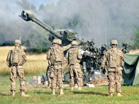 U.S. soldiers fire an M777A2 Howitzer weapons system during an artillery demonstration near Rose Barracks, Germany, July 24, 2015, photo by Sgt. William Tanner/U.S. Army