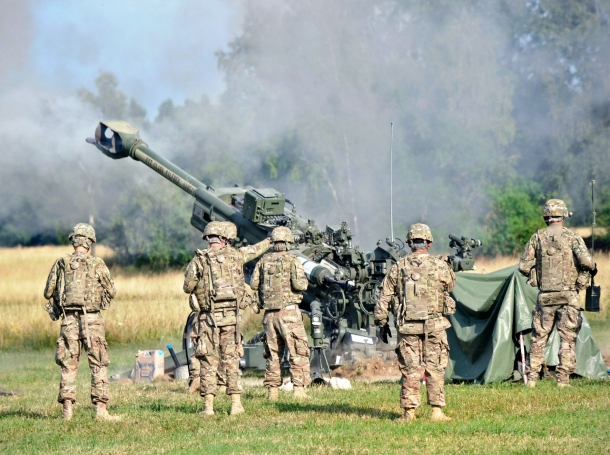 U.S. soldiers fire an M777A2 Howitzer weapons system during an artillery demonstration near Rose Barracks, Germany, July 24, 2015