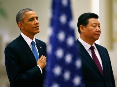 U.S. President Barack Obama and China's President Xi Jinping listen to national anthems during a ceremony in Beijing, November 12, 2014