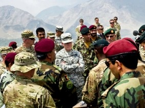 U.S. Army General receives a mountaintop briefing from American and Afghan Special Forces on Camp Moorehead, Afghanistan