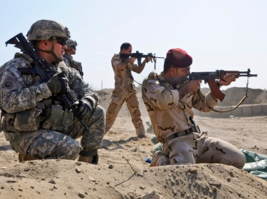 Iraqi soldiers fire at paper targets during the opening of the Anbar Operation Center's shooting range in Ramadi, Iraq, September 10, 2011