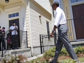 Local residents take pictures as U.S. President Barack Obama visit an area reconstructed after Hurricane Katrina during a presidential visit to New Orleans, Louisiana, August 27, 2015, photo by Carlos Barria/Reuters