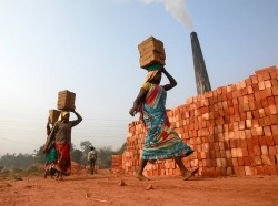 Laborers carry bricks at a brick factory on the outskirts of Agartala, India, January 7, 2015
