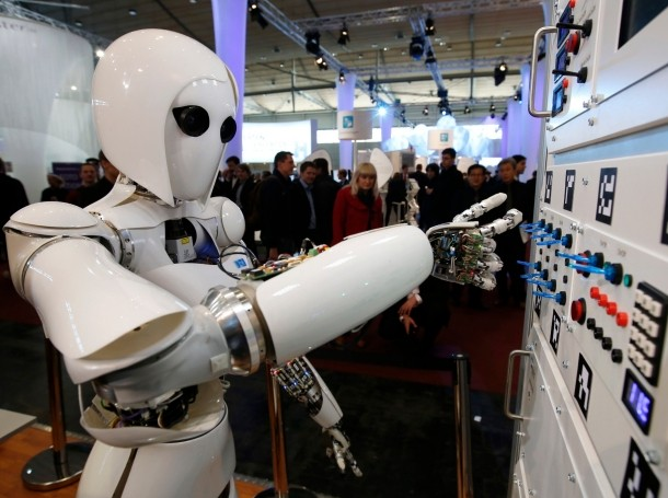 The humanoid robot AILA (artificial intelligence lightweight android) operates a switchboard during a demonstration at the CeBit computer fair in Hanover, Germany, March, 5, 2013