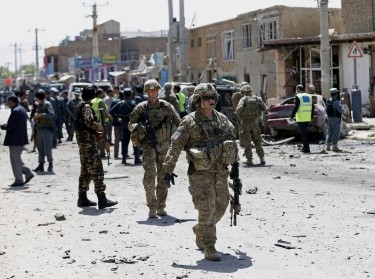 U.S. soldiers arrive at the site of an attack in Kabul, Afghanistan, May 17, 2015
