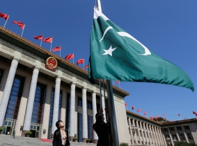 Staff raise Pakistan's flag in front of the Great Hall of the People ahead of a welcome ceremony for Pakistan's Prime Minister Nawaz Sharif in Beijing, July 5, 2013, photo by Jason Lee/Reuters