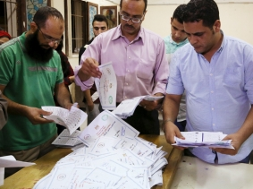 Employees count ballots after the first phase of parliamentary elections in Dokki, Giza governorate, Egypt, October 19, 2015