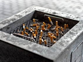 Cigarette butts in a public ashtray, photo by Oliver Sved/Fotolia