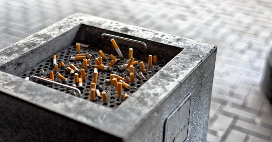 Cigarette butts in a public ashtray