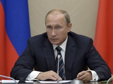Russian President Vladimir Putin chairs a meeting at the Novo-Ogaryovo state residence outside Moscow, September 30, 2015