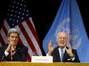 U.S. Secretary of State John Kerry (L), Russian Foreign Minister Sergei Lavrov (R), and UN Envoy for Syria Staffan de Mistura address the media in Vienna, Austria, November 14, 2015