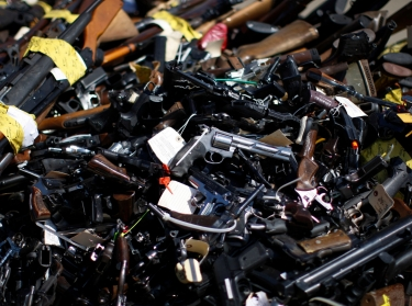 Over 5,000 weapons confiscated from criminals in Los Angeles County and collected through a gun buyback program were  melted and reformed as steel in Rancho Cucamonga, California, July 2013