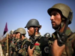 Afghan National Army officers stand at attention at the Kabul Military Training Center, Afghanistan, October 7, 2015