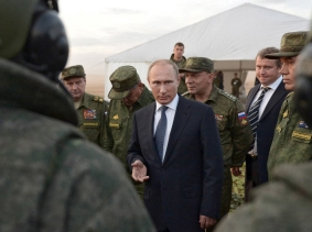 Russian President Vladimir Putin talks to servicemen during a training exercise at the Donguz testing range in Orenburg region, Russia, September 19, 2015