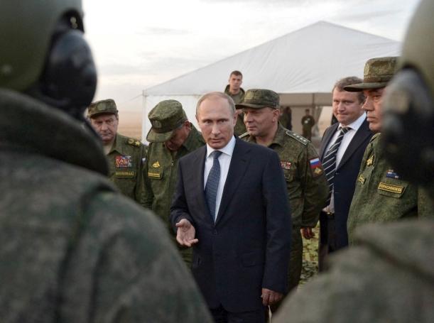 Russian President Vladimir Putin talks to servicemen during a training exercise at the Donguz testing range in Orenburg region, Russia, September 19, 2015