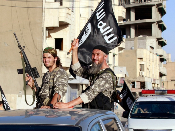 Islamic State fighters take part in a military parade along the streets of northern Raqqa province, Syria, June 30, 2014